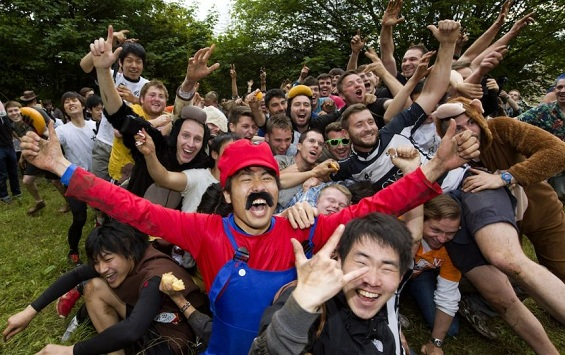 Cheese rolling race participants disguised