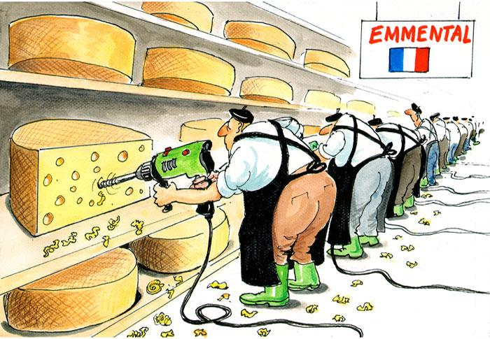 Cheesemaker holing emmental cheese
